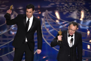 Josh Singer, left, and Tom McCarthy accept the award for best original screenplay for Spotlight