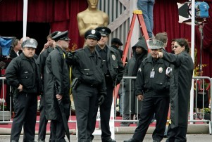 Los Angeles Police Department officers gather outside the Kodak Theatre for the 80th Annual Academy Awards Sunday, Feb. 24, 2008, in the Hollywood section of Los Angeles. (AP Photo/Ric Francis)