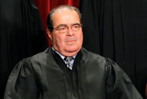 FILE - In this Oct. 8, 2010, file photo, Supreme Court Associate Justice Antonin Scalia is seen during the group portrait of the Supreme Court at the Supreme Court Building in Washington. U.S. Park Police ticketed Scalia after a four-car fender-bender Tuesday, March 29, 2011, along the George Washington Parkway. No one was injured in the accident, police said. (AP Photo/Pablo Martinez Monsivais, File)