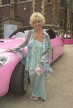 Sylvia Anderson Who Was The Voice Of The Original Lady Penelope In The Thunderbirds Tv Series At The Film Premiere Of Film Thunderbirds At The Empire Leicester Square London Pictured With Lady Penelope's Pink Car From The Film