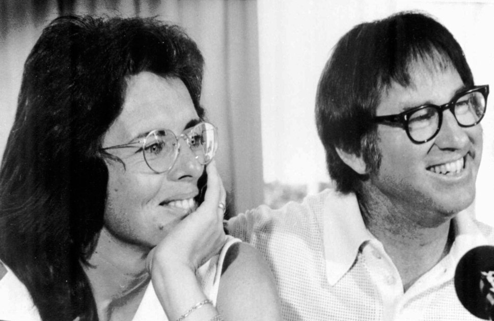 Billie Jean King and Bobby Riggs smile during a news conference in New York to publicize their upcoming match at the Houston Astrodome, July 11, 1973. (AP Photo)