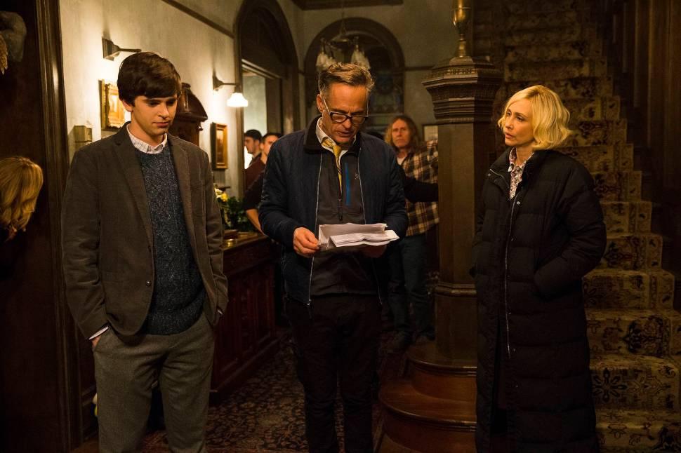 Freddie Highmore and Vera Farmiga run through a scene with director Stephen Surjik.