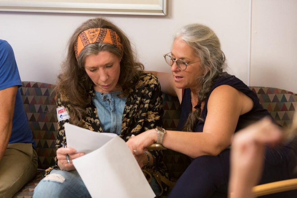 Tomlin looks over the script with Marta Kauffman.