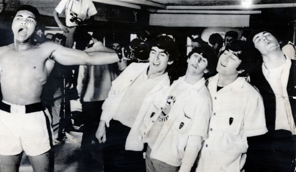 The Beatles George Harrison (died November 2001) Ringo Starr John Lennon (died December 1980) And Paul Mccartney Take A Fake Blow From Cassius Clay While Visiting The Heavyweight Contender''s Training Camp In Miami Beach. 1964