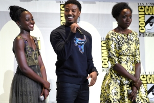 """Lupita Nyong'o, from left, Michael B. Jordan and Danai Gurira attend the """"Black Panther"""" panel on day 3 of Comic-Con International on Saturday, July 23, 2016, in San Diego. (Photo by Chris Pizzello/Invision/AP)"""