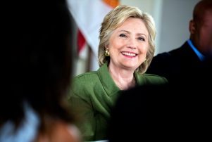 Democratic presidential candidate Hillary Clinton smiles while attending a roundtable with Orlando Mayor Buddy Dyer and community leaders at the Holden Heights Community Center in Orlando, Friday, July 22, 2016 about the attack on the Pulse nightclub.. (AP Photo/Andrew Harnik)