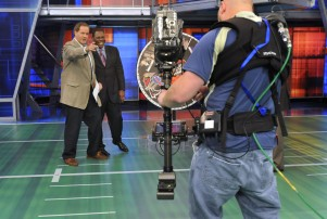 Chris Berman, left, gestures during a live segment of Sunday NFL Countdown with colleague Tom Jackson at ESPN in Bristol, Conn., Sunday, Oct. 26, 2008. Hired by ESPN nearly 30 years ago from his job anchoring weekend sports on local television, Berman has helped change how sports fans get their news and how sportscasters approach their work. (AP Photo/Jessica Hill)