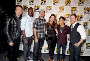 """Ben Affleck, Rick Famuyiwa, Director of """"The Flash"""", David Ayer, Director of """"Suicide Squad"""", Patty Jenkins, Director of """"Wonder Woman"""", James Wan, Director of """"Aquaman"""", and Zack Snyder, Director of """"Batman v Superman: Dawn of Justice"""", seen at Warner Bros. Presentation at 2016 Comic-Con on Saturday, July 23, 2016, in San Diego, Calif. (Photo by Eric Charbonneau/Invision for Warner Bros./AP Images)"""