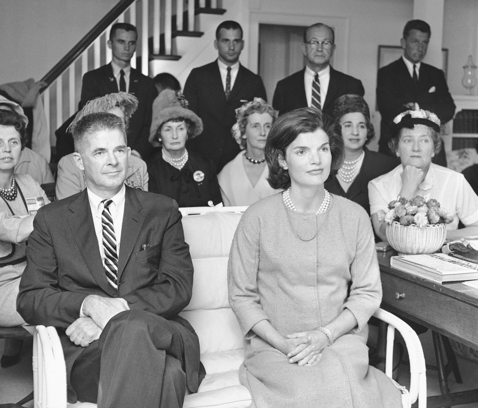 Jacqueline Kennedy, wife of Democratic presidential candidate John F. Kennedy, watches her husband debate with Vice President Richard Nixon on a nation-wide television program, at her Hyannis Port, Mass. home on Sept. 26, 1960. Harvard professer Archibald Cox sits beside Mrs. Kennedy who was host to a group of Democratic party officials and members of the press. (AP Photo/Bill Chaplis)