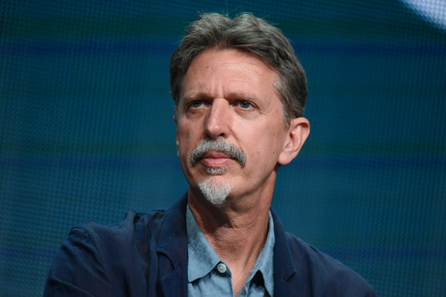 """FILE - In this Aug. 13, 2015 file photo, Executive Producer Tim Kring participates in the """"Heroes Reborn"""" panel at the NBCUniversal Summer TCA Tour in Beverly Hills, Calif. """"Heroes,"""" Kring's mystic, globe-spanning thriller, aired from 2006 to 2010 and then was unceremoniously canceled. Now it's back as """"Heroes Reborn,"""" airing as a 13-episode limited series that debuts with a two-hour opener Thursday at 8 p.m. EDT. (Photo by Richard Shotwell/Invision/AP, File)"""