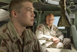 Billy Lynn ( Joe Alwyn) talks to Shroom (Vin Diesel) in TriStar Pictures' BILLY LYNN'S LONG HALFTIME WALK.