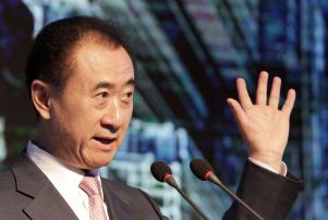 """Copyright 2016 The Associated Press. All rights reserved. This material may not be published, broadcast, rewritten or redistributed without permission. Mandatory Credit: Photo by Gerry Shih/AP/REX/Shutterstock (5768317a) Wang Jianlin, left, chairman of Wanda Group, gestures as he speaks during a ceremony for the """"China Cup"""" at the Sofitel Hotel in Beijing China Cup ceremony, Beijing, China - 13 Jul 2016 Chinese real estate, entertainment and sports conglomerate Wanda says it will host an annual """"China Cup"""" football tournament which will begin next year and feature four national teams."""