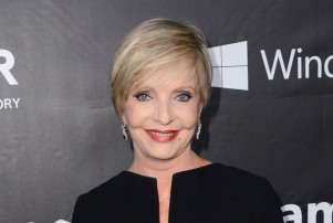 "FILE - In this Oct. 29, 2014 file photo, Florence Henderson arrives at the 2014 amfAR Inspiration Gala at Milk Studios in Los Angeles. Henderson, the wholesome actress who went from Broadway star to television icon when she became Carol Brady, the ever-cheerful mom residing over ""The Brady Bunch,"" has died at age 82. She died surrounded by family and friends, her manager, Kayla Pressman, said in a statement late Thursday, Nov. 24, 2016. (Photo by Jordan Strauss/Invision/AP, File)"