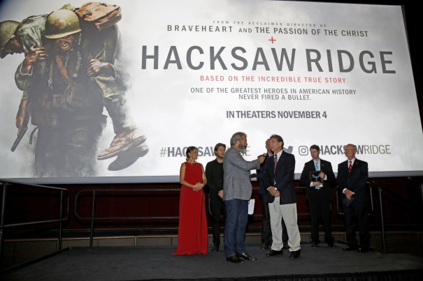 """Mel Gibson, center, interviews Desmond Doss Jr., the son of Congressional Medal of Honor recipient Desmond Doss, at a screening of the movie """"Hacksaw Ridge"""" at The National WWII Museum, in New Orleans, ."""