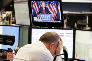 Copyright 2016 The Associated Press. All rights reserved. This material may not be published, broadcast, rewritten or redistributed without permission. Mandatory Credit: Photo by Michael Probst/AP/REX/Shutterstock (7427133a) A broker reacts as President-elect Donald Trump shows up on a television screen at the stock market in Frankfurt, Germany Germany 2016 US Election Financial Markets, Frankfurt, Germany - 09 Nov 2016
