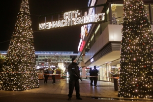 Police guard a Christmas market after a truck ran into a crowded Christmas market and killed several people in Berlin, Germany, Monday, Dec. 19, 2016. (AP Photo/Markus Schreiber)