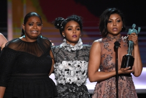 """Octavia Spencer, from left, Janelle Monae, and Taraji P. Henson accept the award for outstanding performance by a cast in a motion picture for """"Hidden Figures"""" at the 23rd annual Screen Actors Guild Awards at the Shrine Auditorium & Expo Hall on Sunday, Jan. 29, 2017, in Los Angeles. (Photo by Chris Pizzello/Invision/AP)"""