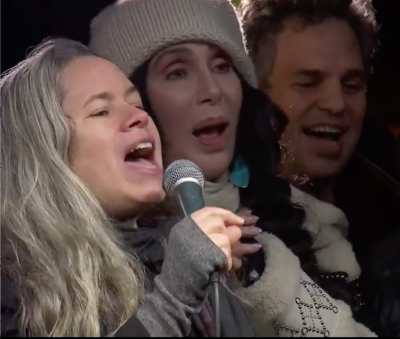 """Natalie Merchant, Cher and Mark Ruffalo lead the crowd in """"This land Is Your land."""""""