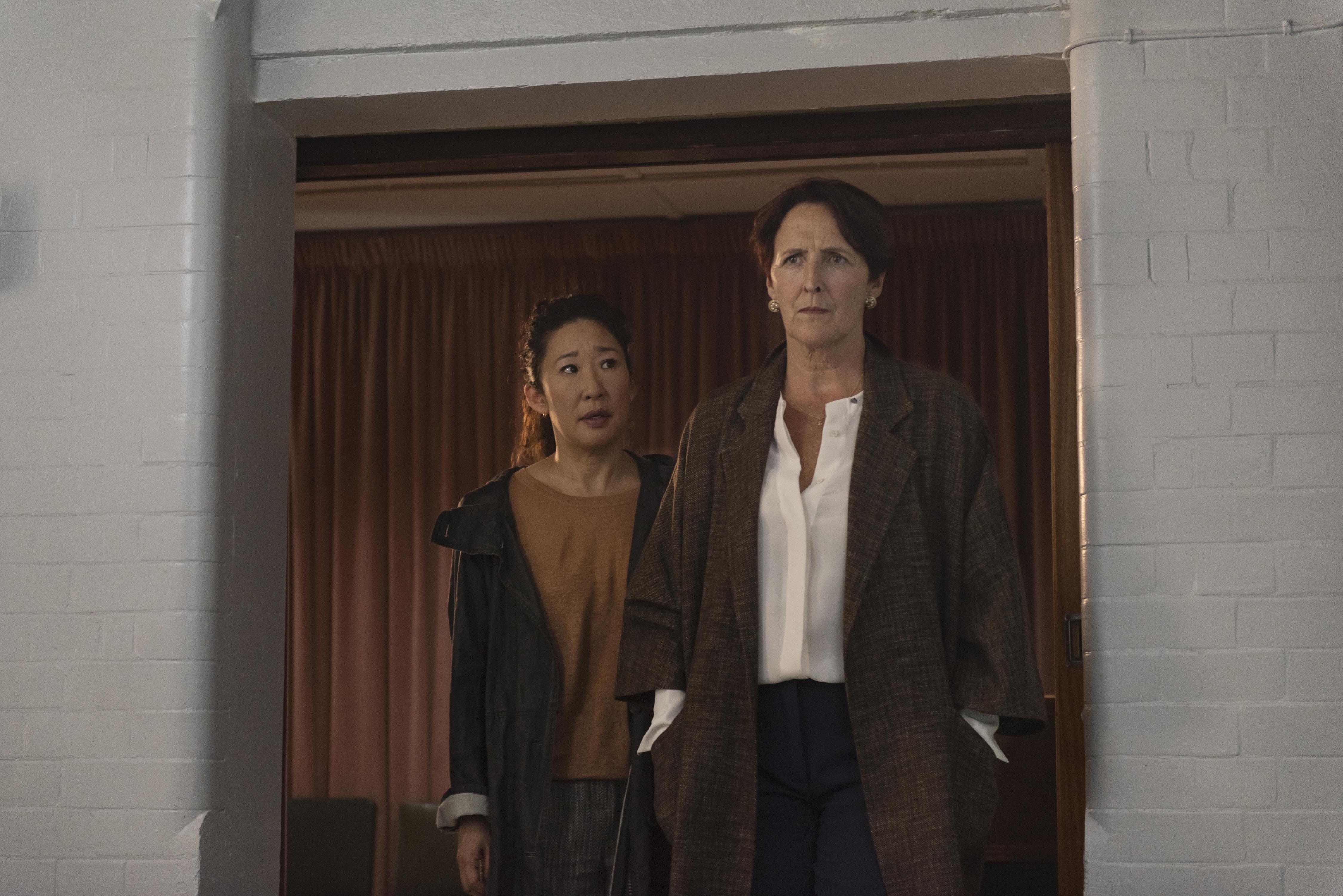 Sandra Oh as Eve Polastri, Fiona Shaw as Carolyn Martens- Killing Eve _ Season 2, Episode 1 - Photo Credit: Parisa Taghizadeh/BBCAmerica