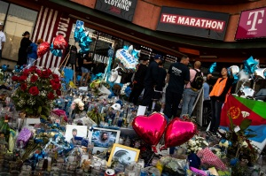 Mandatory Credit: Photo by ETIENNE LAURENT/EPA-EFE/REX/Shutterstock (10185420r) People pay their respects to Nipsey Hussle in front of the rappers shop, 'The Marathon Clothing', where he was shot in Los Angeles, California, USA, 02 April 2019. On 01 April 2019, as people came to pay their respects to Nipsey Hussle, a sudden stampede injured several people, some seriously. Thirty-three-year-old US rapper Nipsey Hussle was shot dead on March 31, in a parking lot in front of his clothing shop. Nipsey Hussle's killing was among the 11 murders within the past week alone in Los Angeles. Nipsey Hussle's death reaction in Los Angeles, USA - 02 Apr 2019
