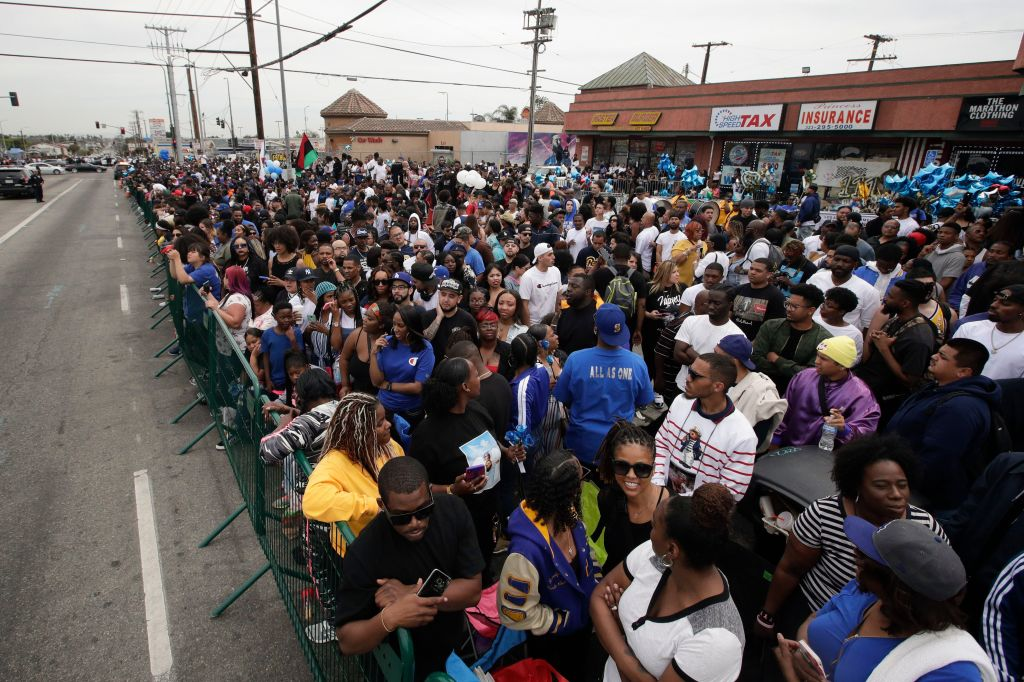 Mandatory Credit: Photo by Jae C Hong/AP/REX/Shutterstock (10199931e) People gather outside The Marathon Clothing store to watch a funeral procession of rapper Nipsey Hussle, in Los Angeles Nipsey Hussle Memorial, Los Angeles, USA - 11 Apr 2019