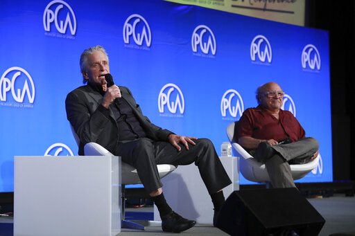 Michael Douglas and Danny DeVito speak at the Produced By Conference at Warner Bros. Studios on Saturday, June 8, 2019, in Burbank, California. (Photo by Mark Von Holden/Invision for Producers Guild of America /AP Images)