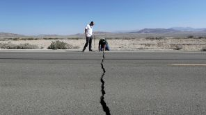 Mandatory Credit: Photo by Marcio Jose Sanchez/AP/Shutterstock (10329284g) Ron Mikulaco, Brad Fernandez. Ron Mikulaco, right, and his nephew, Brad Fernandez, examine a crack caused by an earthquake on Highway 178, outside of Ridgecrest, Calif. Crews in Southern California assessed damage to cracked and burned buildings, broken roads, leaking water and gas lines and other infrastructure Saturday after the largest earthquake the region has seen in nearly 20 years jolted an area from Sacramento to Las Vegas to Mexico California Earthquake, Ridgecrest, USA - 06 Jul 2019