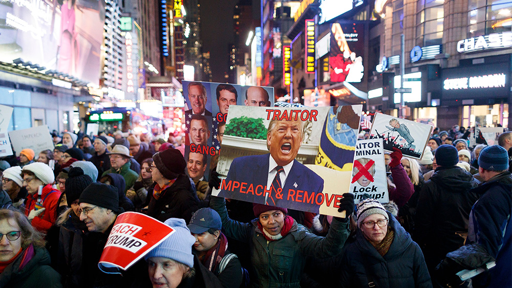Impeachment Rally New York. Rally in Support of Impeachment of President Trump in New York, USA - 17 Dec 2019 People march during a rally in support of the expected vote by the US House of Representatives on two articles of impeachment a day later against US President Donald Trump, in Times Square in New York, New York, USA, 17 December 2019. Citizens around the country held rallies calling for the impeachment and removal of President Donald J. Trump.