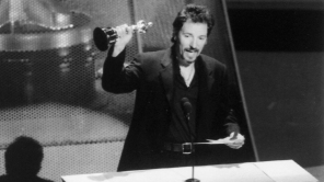 """Bruce Springsteen holds up the Oscar he won for Best Original Song for """"Streets of Philadelphia"""", at the 66th annual Academy Awards"""