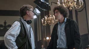 Director Aaron Sorkin and Sacha Baron Cohen on set of 'The Trial of the Chicago 7'
