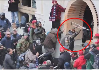 Crutch-Wielding Capitol Rioter Identified As Ex-Actor & Indie Film Producer Luke Coffee; Charges Include Assault With Dangerous Weapon.jpg