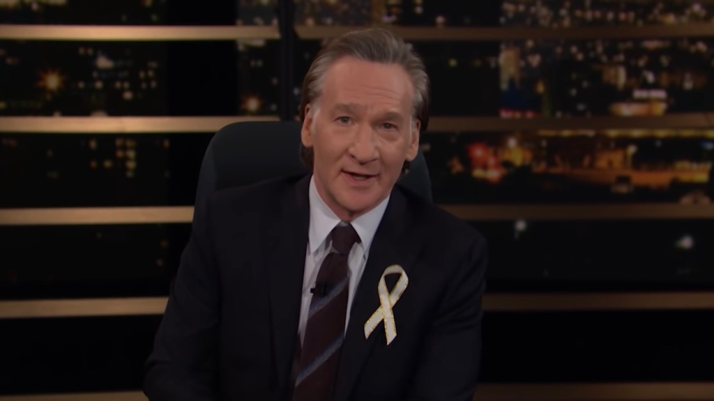 "Bill Maher Honors Awards Season By Donning Lapel Ribbon To ""Raise Awareness Of The Growing Epidemic … Of Raising Awareness"".jpg"